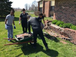 1 RAAC Students work on updating their building's exterior.